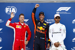 Daniel Ricciardo, Red Bull Racing, celebrates pole position between Sebastian Vettel, Ferrari, and Lewis Hamilton, Mercedes AMG F1