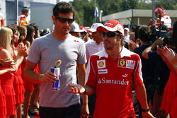 Mark Webber, Red Bull Racing, with Fernando Alonso, Ferrari