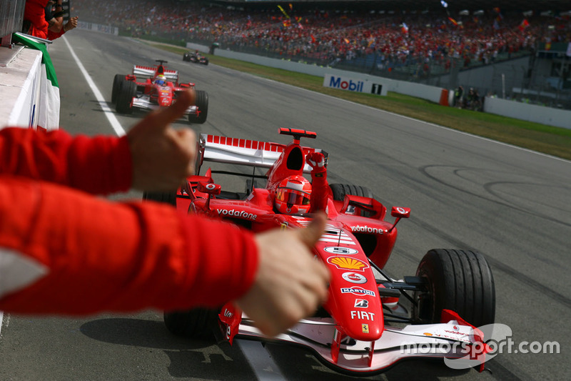 German GP winner Michael Schumacher, Ferrari, second place Felipe Massa, Ferrari