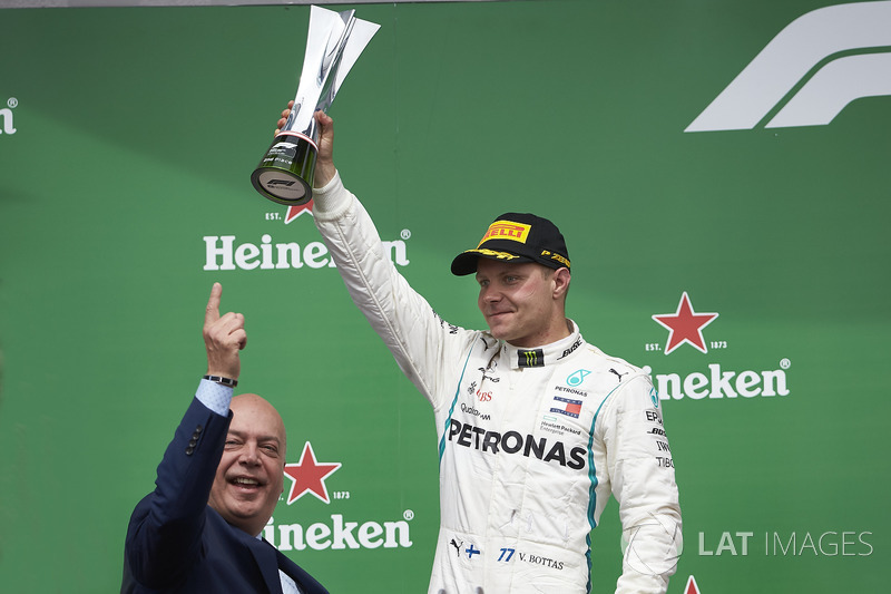 Valtteri Bottas, Mercedes AMG F1, 2nd position, lifts his trophy on the podium