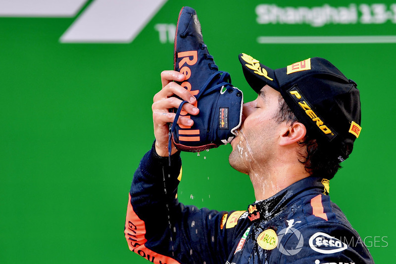 Race winner Daniel Ricciardo, Red Bull Racing celebrates on the podium with a shoey
