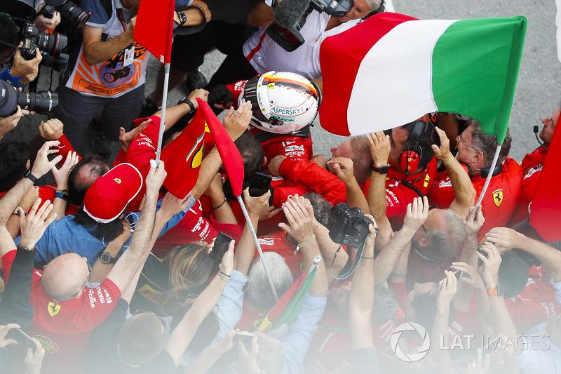 Sebastian Vettel, Ferrari, celebrates victory in parc ferme with his team