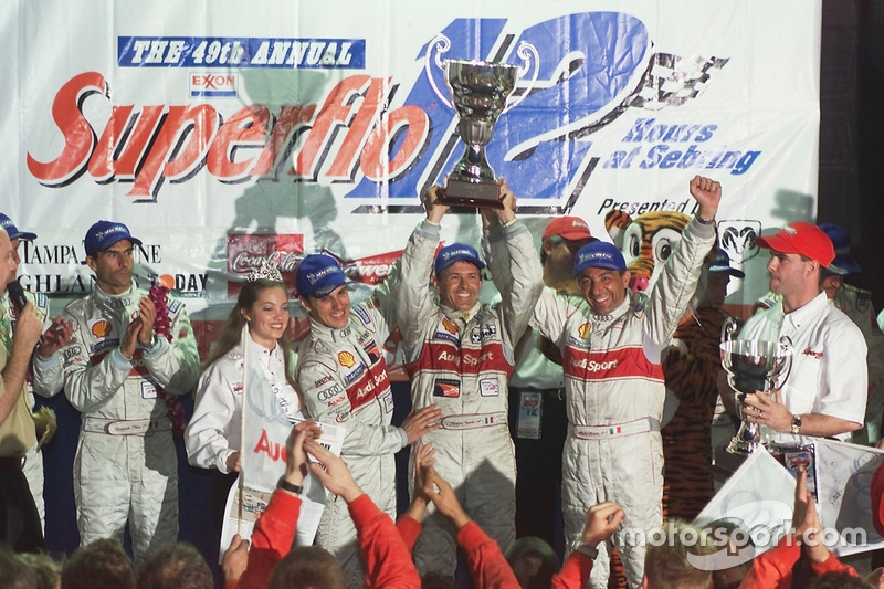 Laurent Aiello, Capello, and Alboreto celebrate victory in the 2001 Sebring 12 Hours. Five weeks later, Michele was gone.
