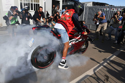 Lewis Hamilton, Mercedes AMG F1 does a burnout on his motorbike