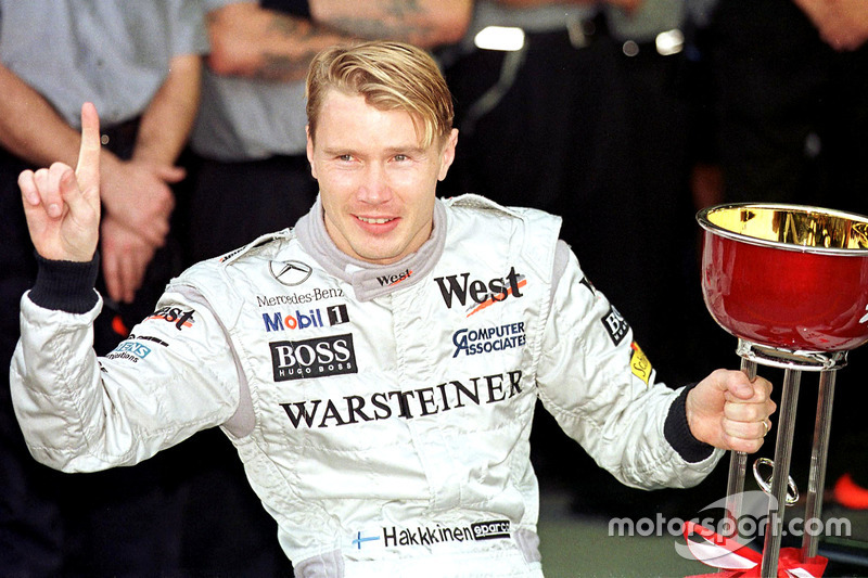 Mika Hakkinen, McLaren celebrates winning the Formula One World Championship