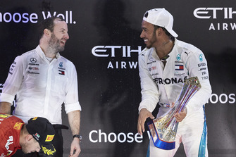 Bradley Lord, Communications Director, Mercedes AMG, and Lewis Hamilton, Mercedes AMG F1, 1st position, on the podium