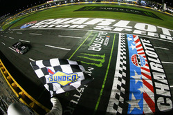 Kyle Busch, Kyle Busch Motorsports Toyota, takes the checkered flag