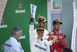 Second place Valtteri Bottas, Mercedes AMG F1, lifts his trophy