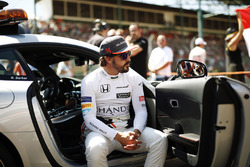 Fernando Alonso, McLaren, sits in an official car