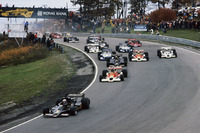 Mario Andretti Lotus 78 Ford leads James Hunt McLaren M26 Ford, Gunnar Nilsson Lotus 78 Ford, Jochen Mass McLaren M26 Ford and Alan Jones Shadow DN8 Ford at the start