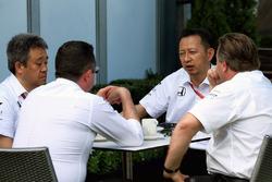 Eric Boullier, McLaren Racing Director and Zak Brown, McLaren Executive Director with Yusuke Hasegawa, Head of Honda F1 Programme