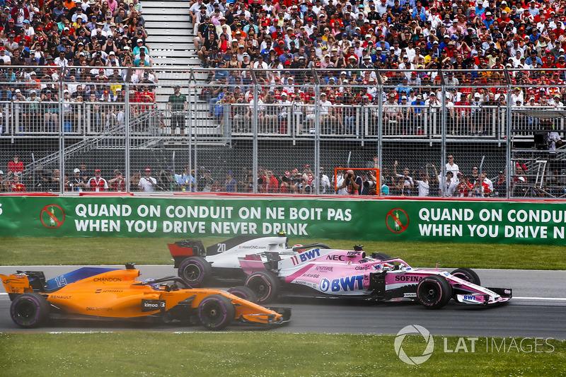 Sergio Perez, Force India VJM11, lotta con Kevin Magnussen, Haas F1 Team VF-18, e Fernando Alonso, McLaren MCL33