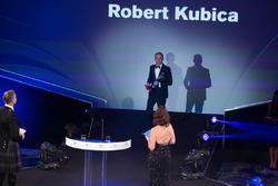 Роберт Кубіца на сцені з ведучими Девідом Култхардом, Лі Макензі