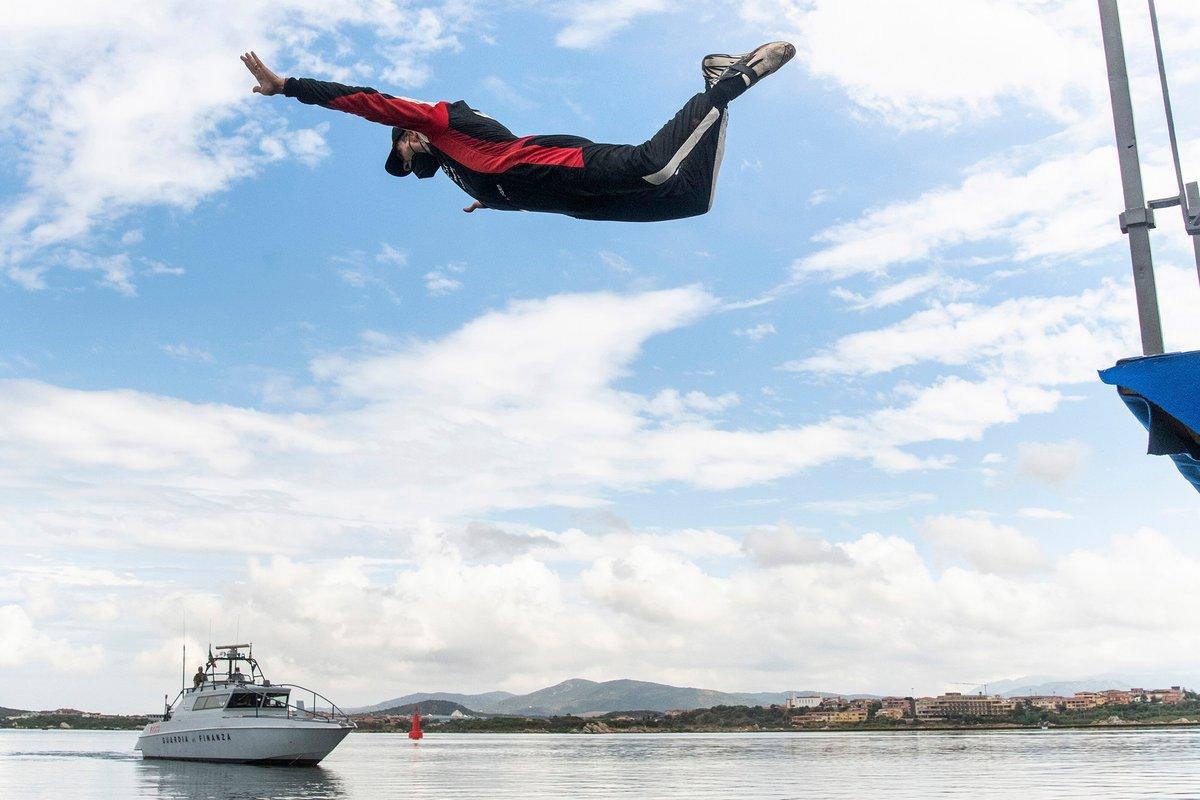 Winner Sebastien Ogier dives into the Mediterranean sea to celebrate victory