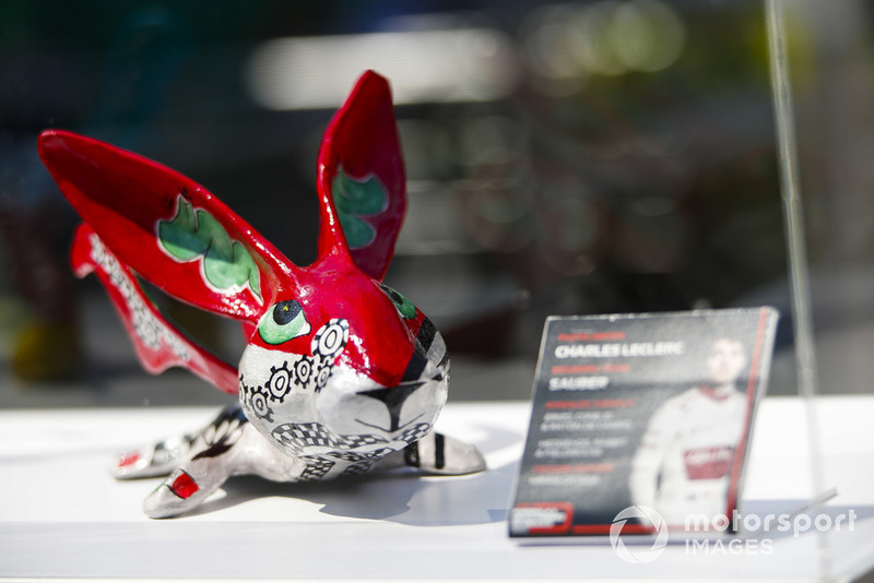 An Alebrijes sculpture on an autograph table for Charles Leclerc, Sauber