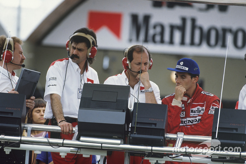 Ayrton Senna, McLaren MP4/4 Honda, DQ, on the pit gantry with Ronnie Peterson Dennis and Gordon Murray