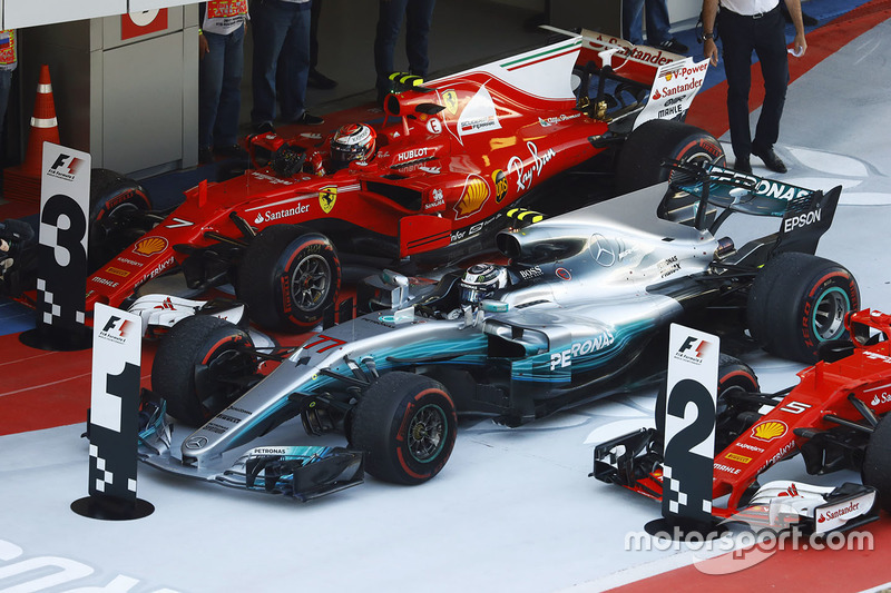 Race winner Valtteri Bottas, Mercedes AMG F1 W08, parks between Kimi Raikkonen, Ferrari SF70H and Sebastian Vettel, Ferrari SF70H