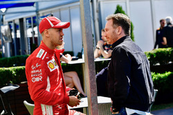 Sebastian Vettel, Ferrari talks with Christian Horner, Red Bull Racing Team Principal