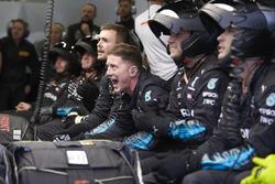 Mercedes pit crew cheer in the garage