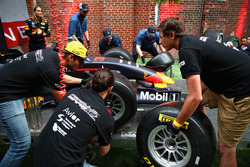 Fans compete in the final of the Red Bull Racing Pit Stop Challenge