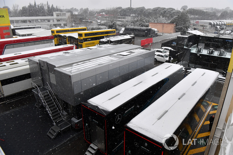 Trucks in the Paddock as snow stops testing