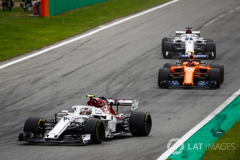 Charles Leclerc, Sauber C37, leads Stoffel Vandoorne, McLaren MCL33, and Marcus Ericsson, Sauber C37