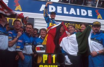 Michael Schumacher, Benetton celebrates with Flavio Briatore, Tom Walkinshaw and the team