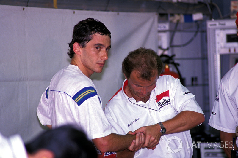 Ayrton Senna receives a hand massage from physio Josef Leberer ahead of the 1988 Mexican Grand Prix