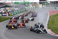 Lewis Hamilton, Mercedes AMG F1 W08, Max Verstappen, Red Bull Racing RB13, Sebastian Vettel, Ferrari SF70H, a locked-up Valtteri Bottas, Mercedes AMG F1 W08, Kimi Raikkonen, Ferrari SF70H, the rest of the pack at the start
