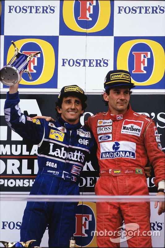 ... holt Prost bei dessen letzer Siegerehrung auf die höchste Stufe des Podests.
