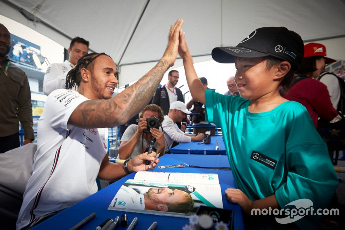 Lewis Hamilton, Mercedes with a young fan