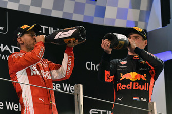Sebastian Vettel, Ferrari and Max Verstappen, Red Bull Racing celebrate on the podium