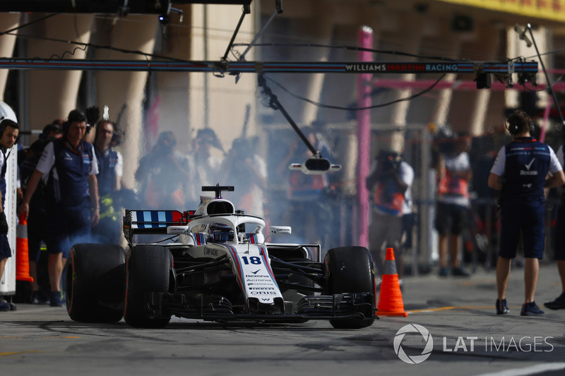 Lance Stroll, Williams FW41 Mercedes, leaves the pits