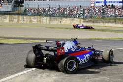 Pierre Gasly, Scuderia Toro Rosso STR12, passes the crashed car of Carlos Sainz Jr., Scuderia Toro Rosso STR12