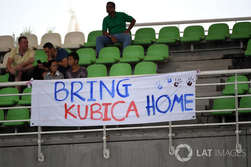 "Fans and ""Bring Kubica Home"" banner signage for Robert Kubica"