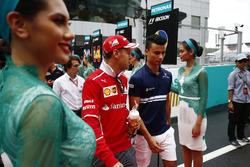 Sebastian Vettel, Ferrari, Pascal Wehrlein, Sauber
