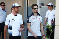 Jenson Button, McLaren and Romain Grosjean, Haas F1 Team