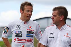 Jenson Button, McLaren with Dr. Aki Hintsa, McLaren Team Doctor