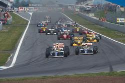 Damon Hill leads Alain Prost, both Williams FW15C Renault's, Ayrton Senna, McLaren MP4/8 Ford, Michael Schumacher, Riccardo Patrese, both Benetton B193B Ford's, Jean Alesi, Ferrari F93A, and Michael Andretti, McLaren MP4/8 Ford, at the start