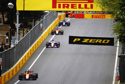 Stoffel Vandoorne, McLaren MCL33 Renault, leads Sergio Perez, Force India VJM11 Mercedes, and Fernando Alonso, McLaren MCL33 Renault
