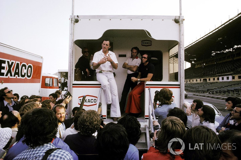 Graham Hill, Hill Team Owner, as a GPDA representative, explains from the back of the McLaren motorhome on the Friday of the meeting, the drivers decision to strike over the poor condition of the guardrail lining the street circuit