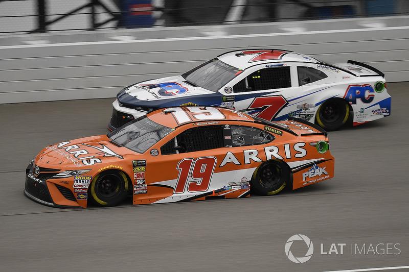 Daniel Suarez, Joe Gibbs Racing, Toyota Camry ARRIS and D.J. Kennington, Premium Motorsports, Chevrolet Camaro APC