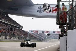 Lewis Hamilton, Mercedes W05, takes the chequered flag
