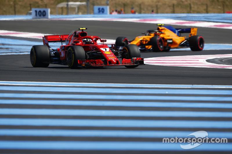 Kimi Raikkonen, Ferrari SF71H, leads Stoffel Vandoorne, McLaren MCL33