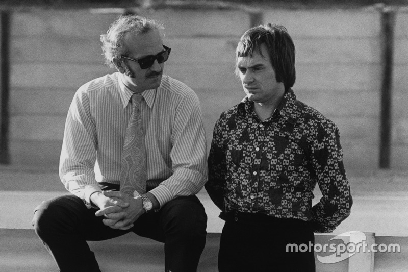 Colin Chapman, Lotus founder with Bernie Ecclestone, Brabham team owner