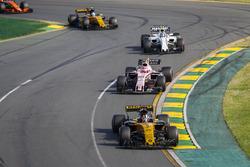 Nico Hulkenberg, Renault Sport F1 Team RS17, leads Esteban Ocon, Force India VJM10, Lance Stroll, Williams FW40, and Jolyon Palmer, Renault Sport F1 Team RS17