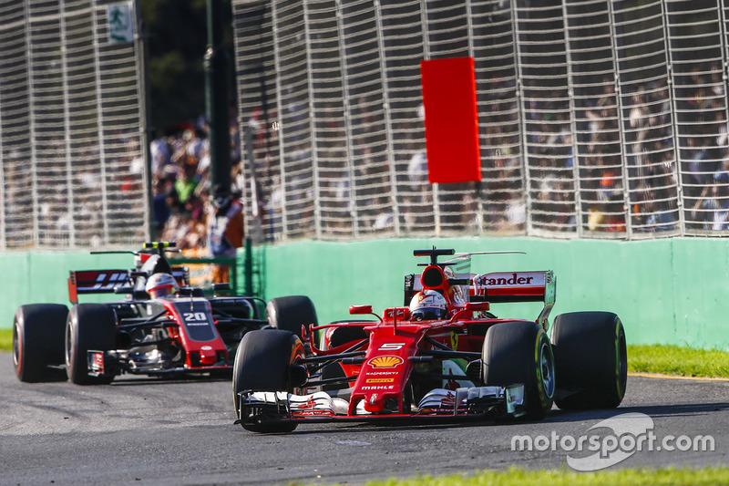 Sebastian Vettel, Ferrari, SF70H; Kevin Magnussen, Haas F1 Team, VF-17