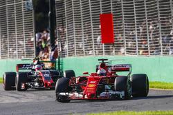 Sebastian Vettel, Ferrari SF70H, leads Kevin Magnussen, Haas F1 Team VF-17