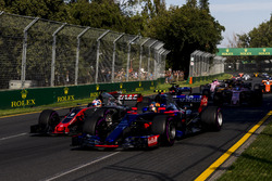 Carlos Sainz Jr., Scuderia Toro Rosso STR12, leads Romain Grosjean, Haas F1 Team VF-17