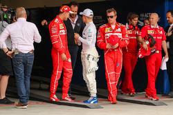 Pole sitter Valtteri Bottas, Mercedes AMG F1 celebrates in parc ferme with Matteo Bonciani, FIA Media Delegate, Sebastian Vettel, Ferrari and Kimi Raikkonen, Ferrari